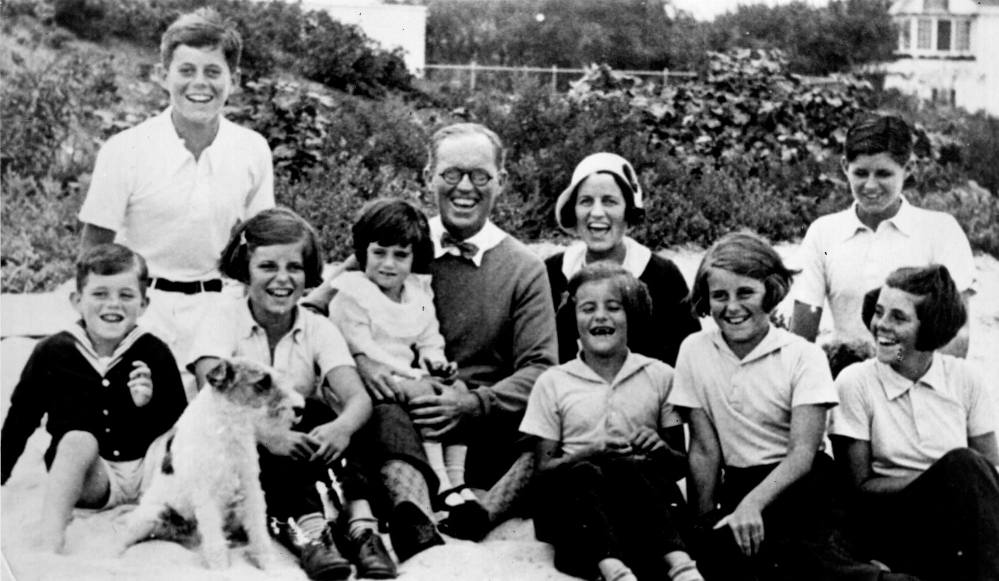 <div class='meta'><div class='origin-logo' data-origin='none'></div><span class='caption-text' data-credit='Photo by Richard Sears - provided by Mikki Ansin /Liaison Agency via Getty'>The Kennedy clan in 1931 in Hyannisport, MA.</span></div>