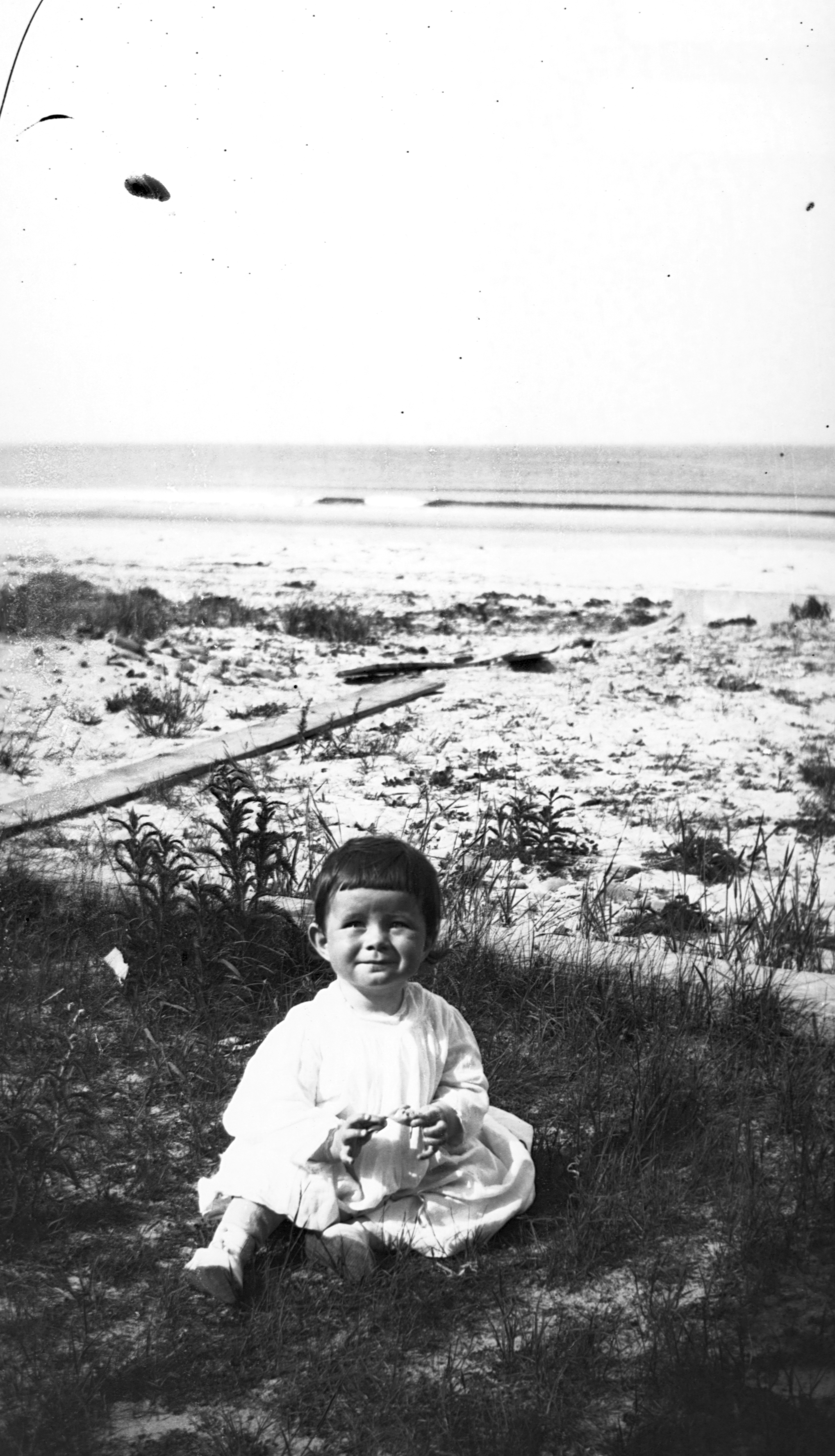 <div class='meta'><div class='origin-logo' data-origin='none'></div><span class='caption-text' data-credit='Corbis via Getty Images'>John F. Kennedy, as a baby, sits in the sand at Nantasket Beach, Massachusetts. Circa 1918.</span></div>