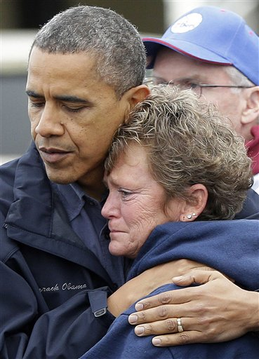 <div class='meta'><div class='origin-logo' data-origin='none'></div><span class='caption-text' data-credit='AP'>President Barack Obama, left, embraces Donna Vanzant, right, during a tour of a neighborhood effected by superstorm Sandy, Wednesday, Oct. 31, 2012 in Brigantine, N.J.</span></div>