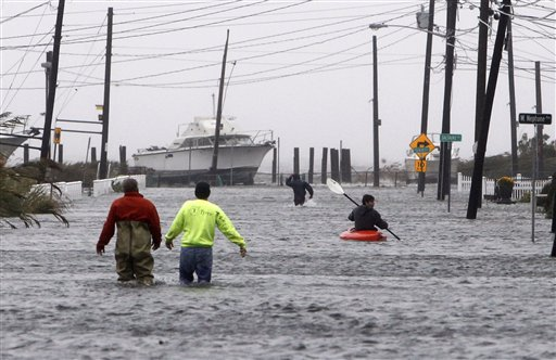 <div class='meta'><div class='origin-logo' data-origin='none'></div><span class='caption-text' data-credit='AP'>People wade and paddle down a flooded street as Hurricane Sandy approaches, Monday, Oct. 29, 2012, in Lindenhurst, N.Y.</span></div>