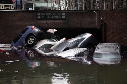 <div class='meta'><div class='origin-logo' data-origin='none'></div><span class='caption-text' data-credit='AP'>n this Tuesday, Oct. 30, 2012, file photo, cars are submerged at the entrance to a parking garage in New York's Financial District in the aftermath of superstorm Sandy.</span></div>
