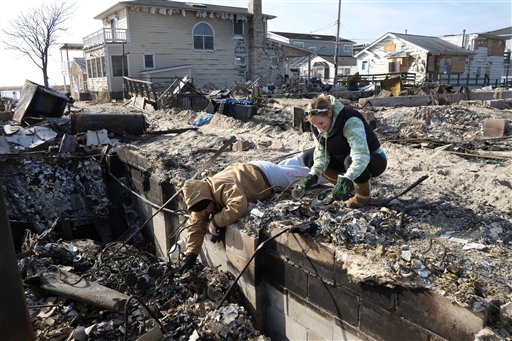 <div class='meta'><div class='origin-logo' data-origin='none'></div><span class='caption-text' data-credit='AP'>Allison Gilmartin and Kelly Johnston in the Breezy Point section of the New York's Queens borough.</span></div>