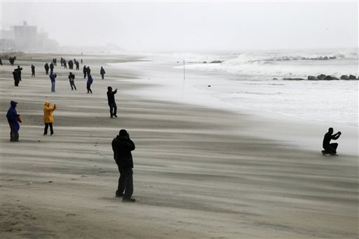 <div class='meta'><div class='origin-logo' data-origin='none'></div><span class='caption-text' data-credit='AP'>People brave high winds and blowing sand as they watch the rising surf at Coney Island Beach in the Brooklyn borough of New York as Hurricane Sandy arrives, Monday, Oct. 29, 2012.</span></div>