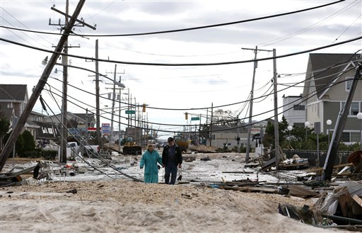 <div class='meta'><div class='origin-logo' data-origin='none'></div><span class='caption-text' data-credit='AP'>Robert Bryce, right, walks with his wife, Marcia Bryce, as destruction from superstorm Sandy is seen on Route 35 in Seaside Heights, N.J., Wednesday, Oct. 31, 2012.</span></div>