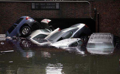 <div class='meta'><div class='origin-logo' data-origin='none'></div><span class='caption-text' data-credit='AP'>Cars are submerged at the entrance to a parking garage in New York's Financial District in the aftermath of superstorm Sandy, Tuesday, Oct. 30, 2012.</span></div>