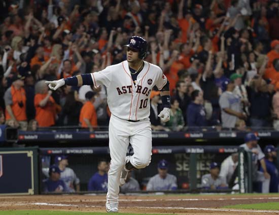 <div class='meta'><div class='origin-logo' data-origin='AP'></div><span class='caption-text' data-credit='AP'>Astros' Yuli Gurriel reacts after hitting a home run during the first inning of Game 3 of baseball's World Series against the Los Angeles Dodgers. (AP Photo/David J. Phillip)</span></div>
