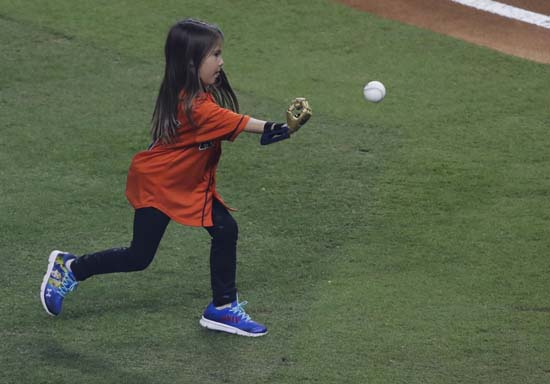 <div class='meta'><div class='origin-logo' data-origin='AP'></div><span class='caption-text' data-credit='AP'>Hailey Dawson throws out the ceremonial first pitch with her 3D printed hand before Game 4 of baseball's World Series. (AP Photo/Eric Gay)</span></div>