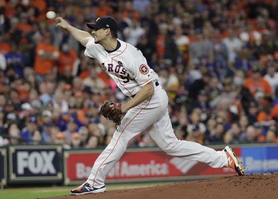 <div class='meta'><div class='origin-logo' data-origin='AP'></div><span class='caption-text' data-credit='AP'>Houston Astros starting pitcher Charlie Morton throws during the first inning of Game 4 of baseball's World Series against the Los Angeles Dodgers. (AP Photo/David J. Phillip)</span></div>