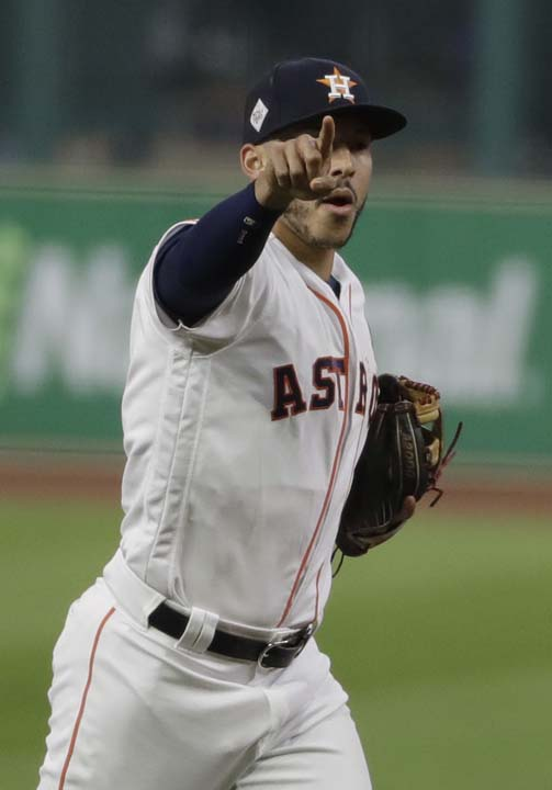 <div class='meta'><div class='origin-logo' data-origin='AP'></div><span class='caption-text' data-credit='AP'>Houston Astros shortstop Carlos Correa celebrates after the last out in the top of the first inning of Game 4 of baseball's World Series. (AP Photo/Matt Slocum)</span></div>