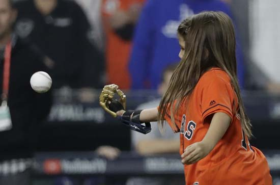 <div class='meta'><div class='origin-logo' data-origin='AP'></div><span class='caption-text' data-credit='AP'>Hailey Dawson throws out the ceremonial first pitch with her 3D printed hand before Game 4 of baseball's World Series. (AP Photo/David J. Phillip)</span></div>