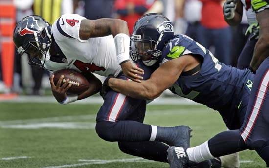 <div class='meta'><div class='origin-logo' data-origin='AP'></div><span class='caption-text' data-credit='AP'>Houston Texans quarterback Deshaun Watson (4) is sacked by Seattle Seahawks defensive end Michael Bennett in the first half. (AP Photo/Elaine Thompson)</span></div>