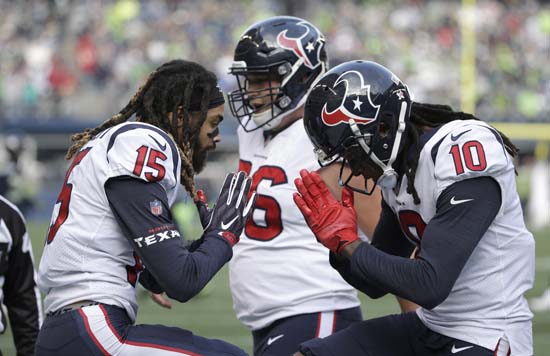 <div class='meta'><div class='origin-logo' data-origin='AP'></div><span class='caption-text' data-credit='AP'>Houston Texans wide receiver Will Fuller (15) celebrates with wide receiver DeAndre Hopkins (10) after Fuller scored a touchdown. (AP Photo/Elaine Thompson)</span></div>