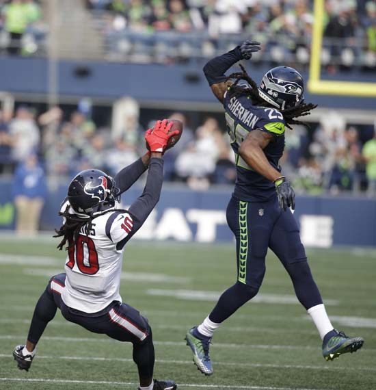 <div class='meta'><div class='origin-logo' data-origin='AP'></div><span class='caption-text' data-credit='AP'>Houston Texans wide receiver DeAndre Hopkins (10) makes a catch behind Seattle Seahawks. (AP Photo/Elaine Thompson)</span></div>