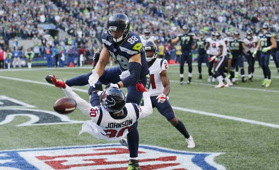 <div class='meta'><div class='origin-logo' data-origin='AP'></div><span class='caption-text' data-credit='AP'>Houston Texans cornerback Kevin Johnson (30) breaks up a pass intended for Seattle Seahawks tight end Jimmy Graham (88), in the second half. (AP Photo/Stephen Brashear)</span></div>