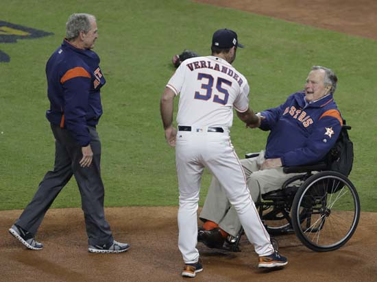 <div class='meta'><div class='origin-logo' data-origin='AP'></div><span class='caption-text' data-credit='AP'>Houston Astros' Justin Verlander shakes hands with Former President George H.W. Bush after George W. Bush threw the ceremonial first pitch before Game 5. (AP Photo/Eric Gay)</span></div>