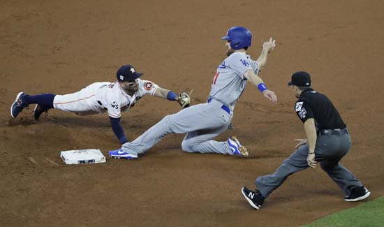 <div class='meta'><div class='origin-logo' data-origin='AP'></div><span class='caption-text' data-credit='AP'>Los Angeles Dodgers' Logan Forsythe steals second with Houston Astros' Jose Altuve covering during the first inning of Game 5. (AP Photo/Eric Gay)</span></div>