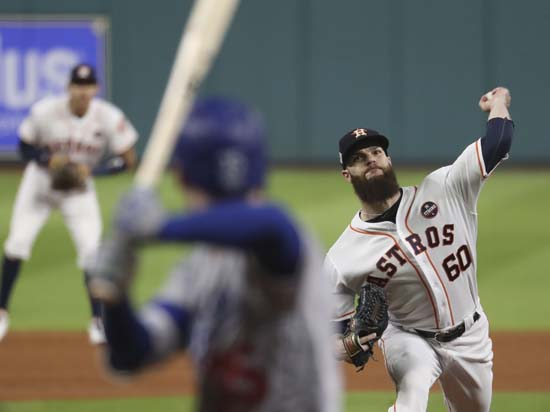 <div class='meta'><div class='origin-logo' data-origin='AP'></div><span class='caption-text' data-credit='AP'>Houston Astros starting pitcher Dallas Keuchel throws during the first inning of Game 5 of baseball's World Series. (AP Photo/Thomas B. Shea, Pool)</span></div>