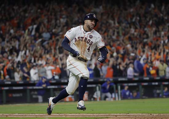 <div class='meta'><div class='origin-logo' data-origin='AP'></div><span class='caption-text' data-credit='AP'>Houston Astros' George Springer celebrates his home run during the seventh inning of Game 5 of baseball's World Series against the Los Angeles Dodgers. (AP Photo/David J. Phillip)</span></div>