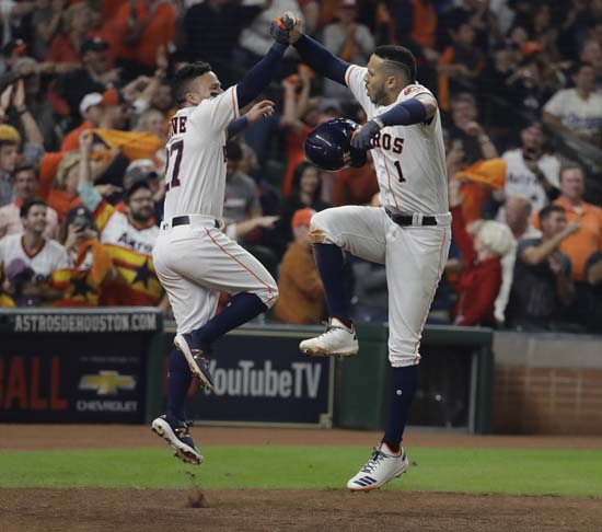 <div class='meta'><div class='origin-logo' data-origin='AP'></div><span class='caption-text' data-credit='AP'>Houston Astros' Carlos Correa celebrates his two-run home run with Jose Altuve during the seventh inning of Game 5. (AP Photo/David J. Phillip)</span></div>