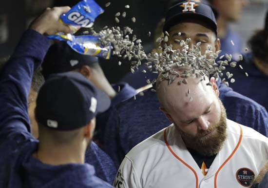 <div class='meta'><div class='origin-logo' data-origin='AP'></div><span class='caption-text' data-credit='AP'>Houston Astros' Brian McCann is congratulated after hitting a home run during the eighth inning of Game 5. (AP Photo/David J. Phillip)</span></div>
