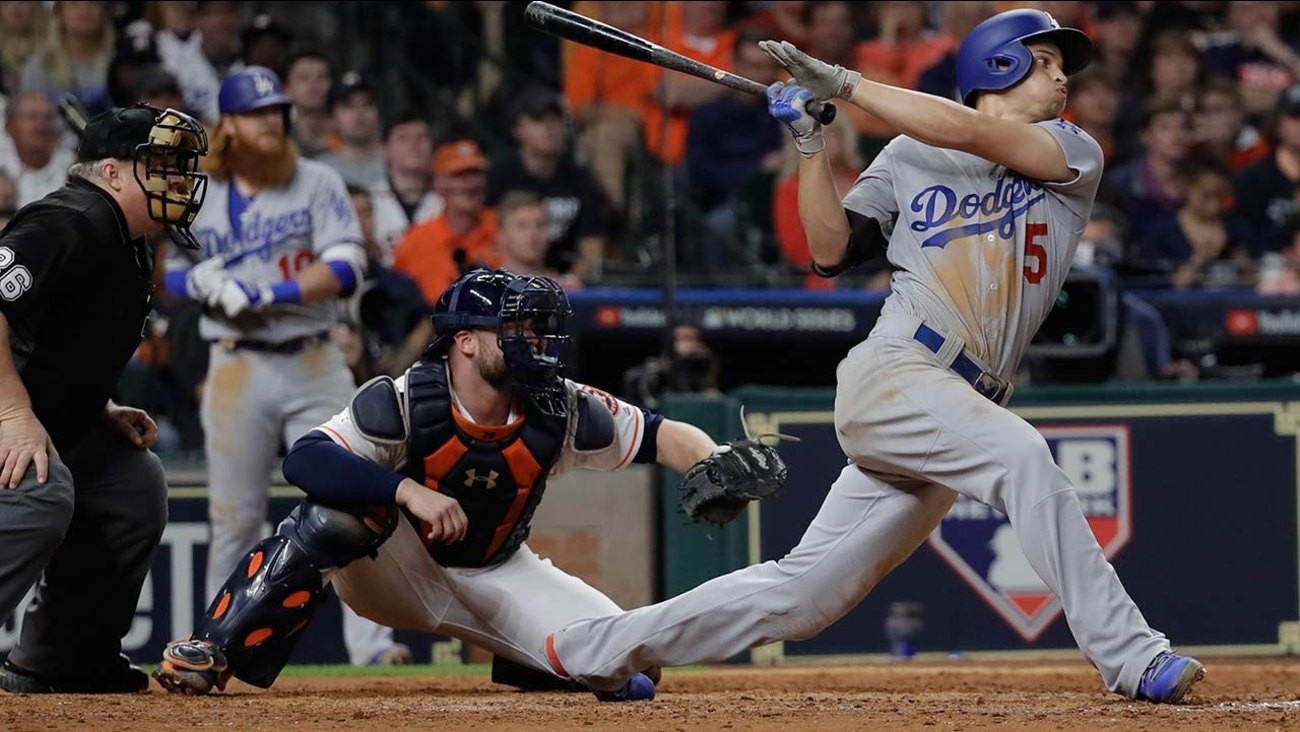 Los Angeles Dodgers' Corey Seager hits an RBI double during the eighth inning of Game 5 of baseball's World Series against the Houston Astros Sunday, Oct. 29, 2017, in Houston.
