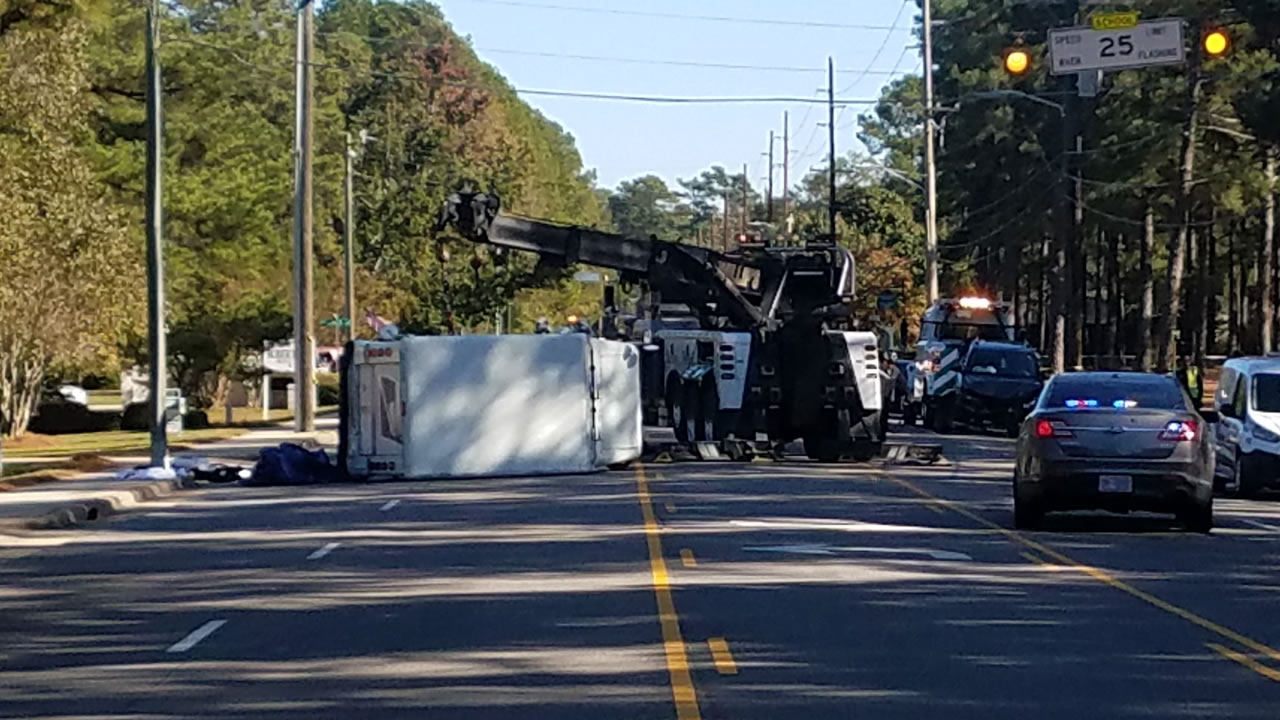 A mail truck was left on its side after the crash.