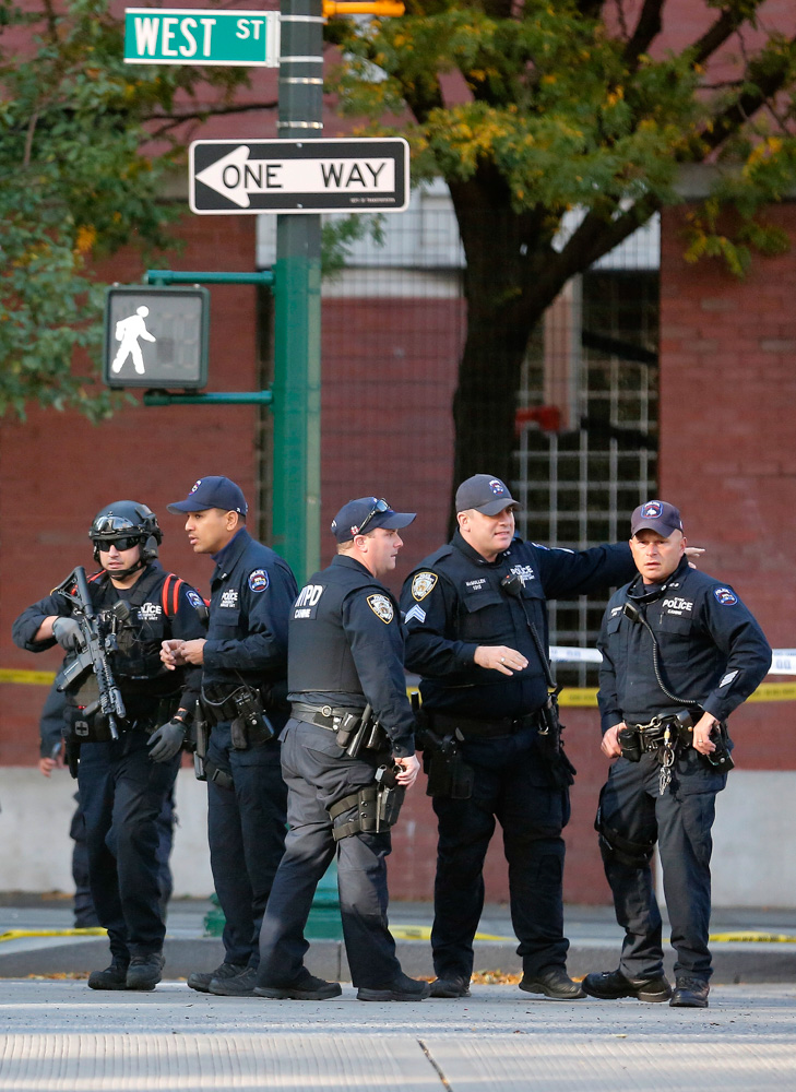 <div class='meta'><div class='origin-logo' data-origin='none'></div><span class='caption-text' data-credit='Bebeto Matthews/AP Photo'>New York Police Department officers gather near the scene Tuesday Oct. 31, 2017, in New York.</span></div>