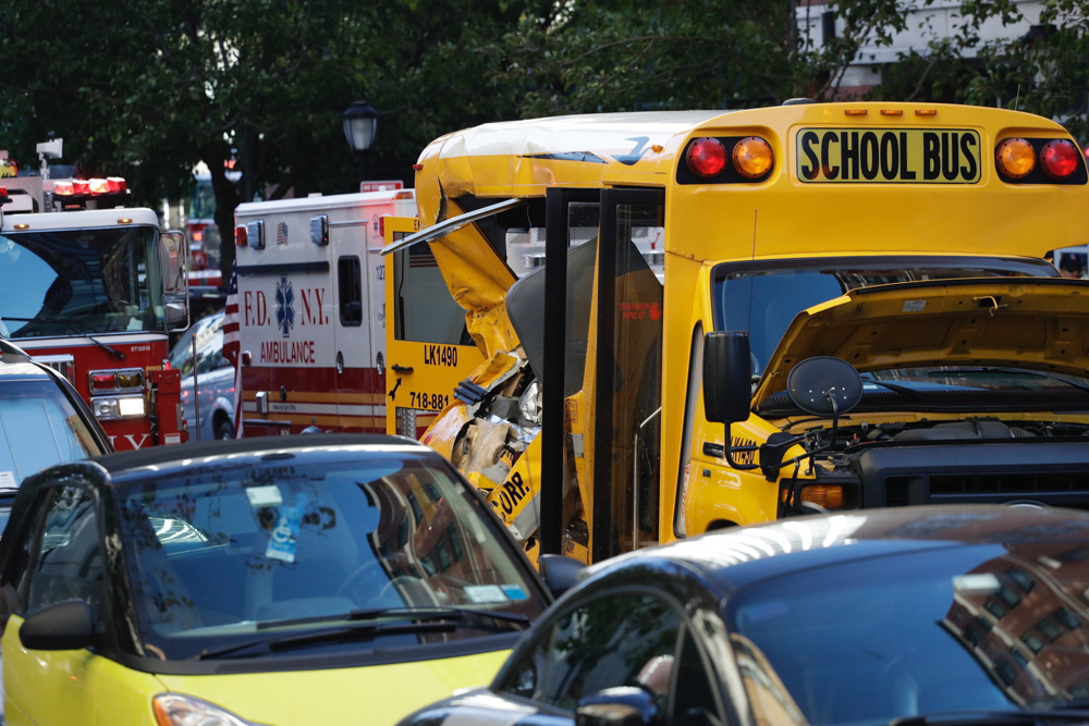 <div class='meta'><div class='origin-logo' data-origin='none'></div><span class='caption-text' data-credit='Mark Lennihan/AP Photo'>Authorities respond near a damaged school bus. A motorist drove onto a busy bicycle path near the World Trade Center memorial and struck several people police and witnesses said.</span></div>