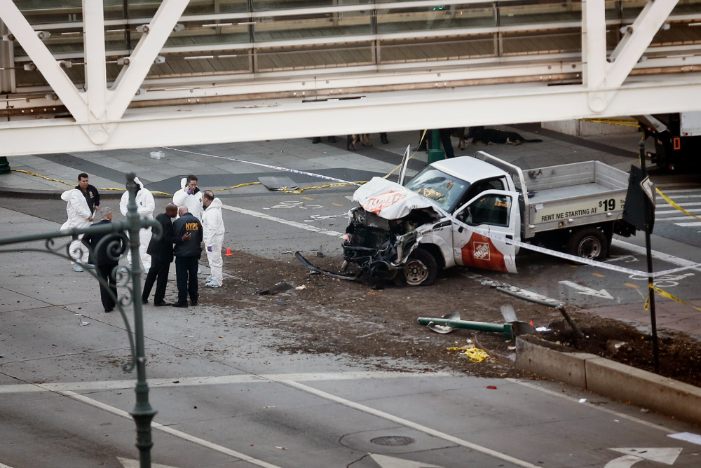 <div class='meta'><div class='origin-logo' data-origin='none'></div><span class='caption-text' data-credit='Bebeto Matthews/AP Photo'>Authorities stand near a damaged Home Depot truck after a motorist drove onto a bike path near the World Trade Center memorial, striking and killing several people.</span></div>