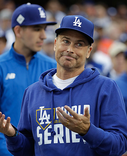 <div class='meta'><div class='origin-logo' data-origin='AP'></div><span class='caption-text' data-credit='AP Photo/David J. Phillip'>Actor Rob Lowe gestures before Game 6 of the World Series between the Houston Astros and the Los Angeles Dodgers Tuesday, Oct. 31, 2017, in Los Angeles.</span></div>