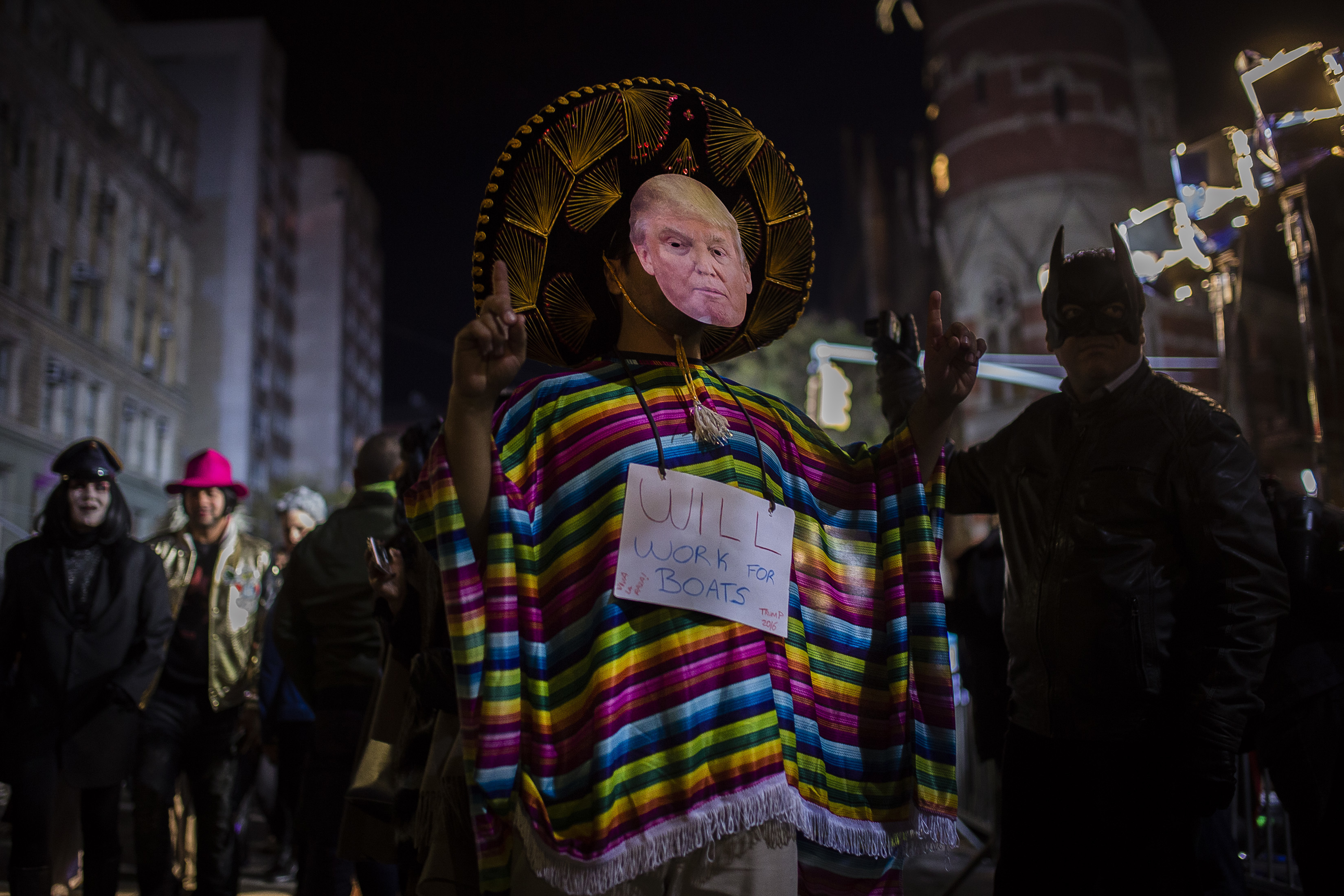 "<div class=""meta image-caption""><div class=""origin-logo origin-image none""><span>none</span></div><span class=""caption-text"">A reveler wearing a Donald Trump mask marches during the Greenwich Village Halloween Parade in New York, Monday, Oct. 31, 2016. (AP Photo/Andres Kudacki)</span></div>"