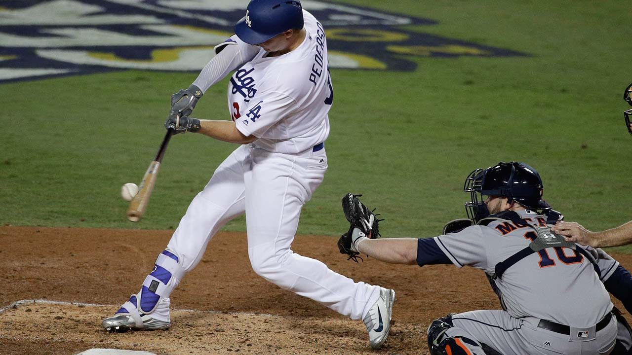 Los Angeles Dodgers' Joc Pederson hits a home run against the Houston Astros during the seventh inning of Game 6 of baseball's World Series Tuesday, Oct. 31, 2017, in Los Angeles.