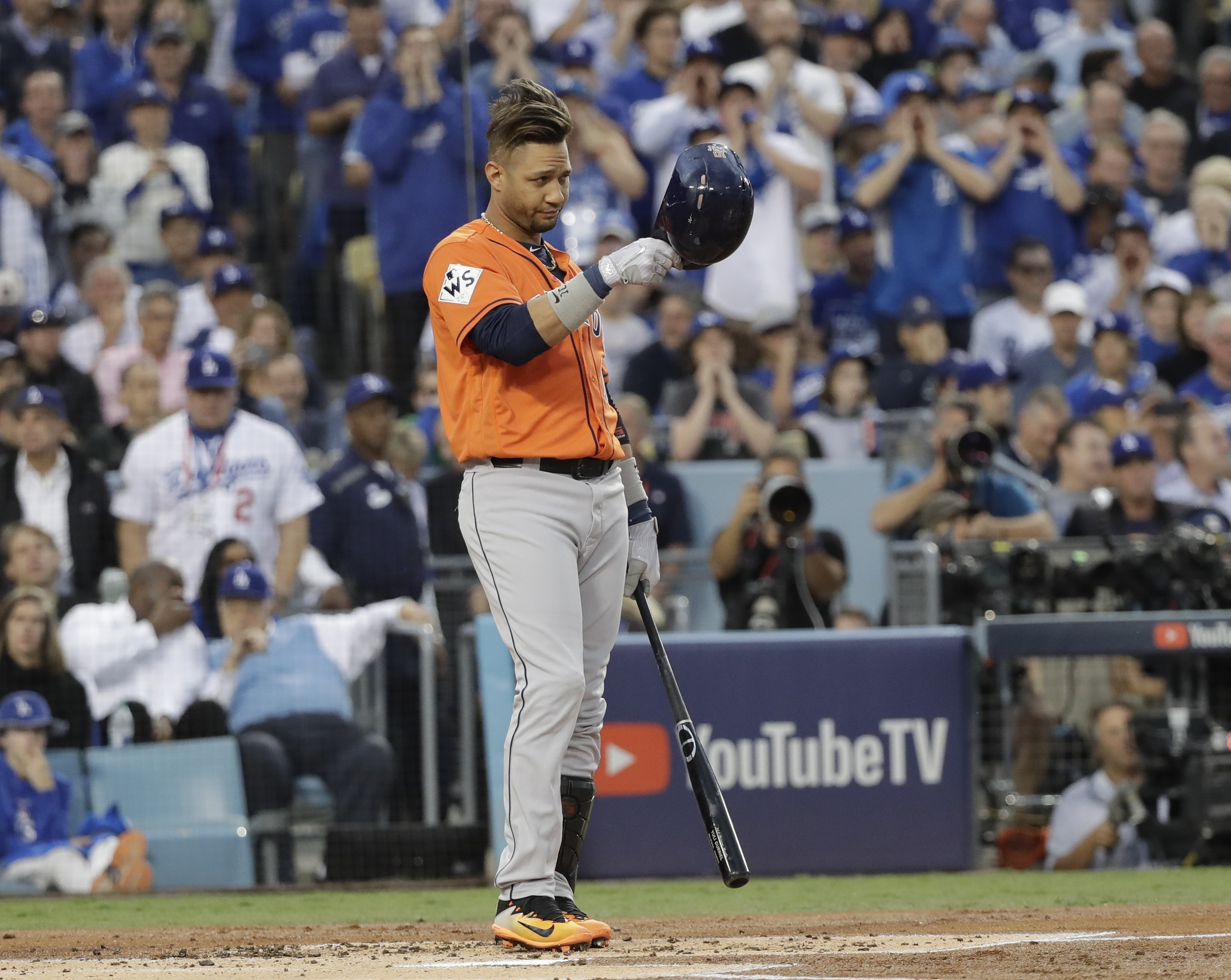 <div class='meta'><div class='origin-logo' data-origin='AP'></div><span class='caption-text' data-credit='AP'>Houston Astros' Yuli Gurriel tips his hat as he gestures to Los Angeles Dodgers starting pitcher Yu Darvish during the first inning of Game 7. (AP Photo/David J. Phillip)</span></div>