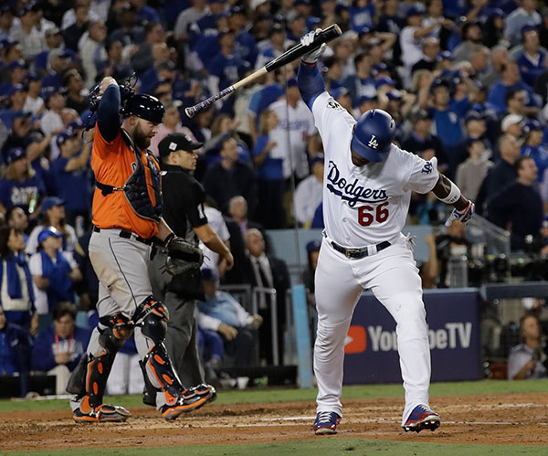 <div class='meta'><div class='origin-logo' data-origin='AP'></div><span class='caption-text' data-credit='AP Photo/David J. Phillip'>Dodger Yasiel Puig throws his bat after flying out in the third inning of Game 7 of the World Series against the Houston Astros on Wednesday, Nov. 1, 2017 in Los Angeles.</span></div>