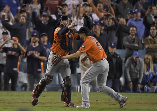 <div class='meta'><div class='origin-logo' data-origin='AP'></div><span class='caption-text' data-credit='AP'>Houston Astros catcher Brian McCann and Charlie Morton celebrate after win against the Los Angeles Dodgers in Game 7. (AP Photo/Mark J. Terrill)</span></div>