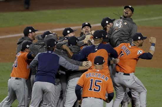 <div class='meta'><div class='origin-logo' data-origin='AP'></div><span class='caption-text' data-credit='AP'>Members the the Houston Astros celebrate their win against the Los Angeles Dodgers in Game 7 of baseball's World Series. (AP Photo/Alex Gallardo)</span></div>