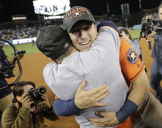 "<div class=""meta image-caption""><div class=""origin-logo origin-image ap""><span>AP</span></div><span class=""caption-text"">Houston Astros' Jose Altuve and Alex Bregman celebrate after Game 7. (AP Photo/David J. Phillip) (AP)</span></div>"
