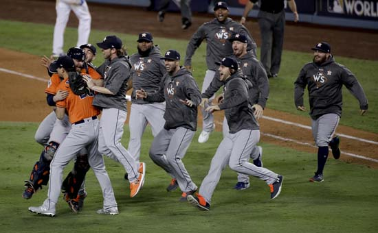 "<div class=""meta image-caption""><div class=""origin-logo origin-image ap""><span>AP</span></div><span class=""caption-text"">Members the the Houston Astros celebrate their win against the Los Angeles Dodgers in Game 7 of baseball's World Series. (AP Photo/Jae C. Hong) (AP)</span></div>"