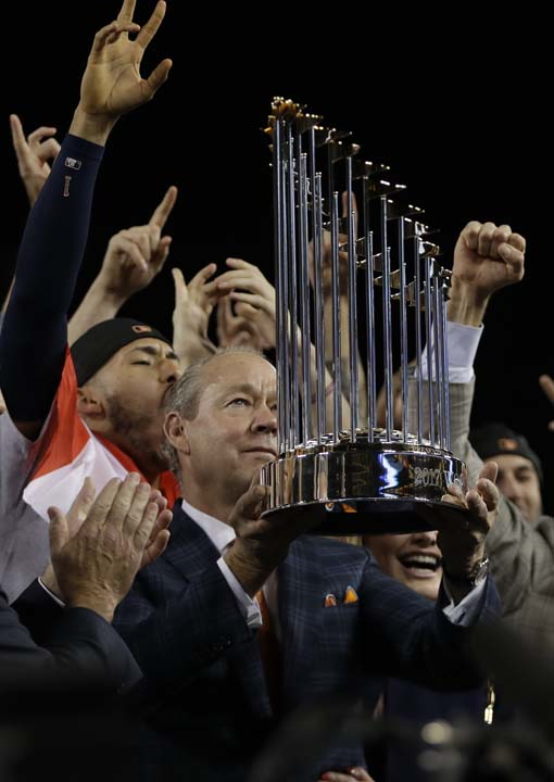 "<div class=""meta image-caption""><div class=""origin-logo origin-image ap""><span>AP</span></div><span class=""caption-text"">Houston Astros owner Jim Crane holds the championship trophy after Game 7 of baseball's World Series against the Los Angeles Dodgers. (AP Photo/Matt Slocum) (AP)</span></div>"