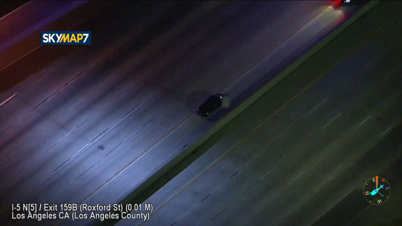 A suspect blacked out their lights as they drove on the northbound 5 Freeway in Los Angeles as a CHP cruiser was right behind them on Wednesday, Nov. 1, 2017.