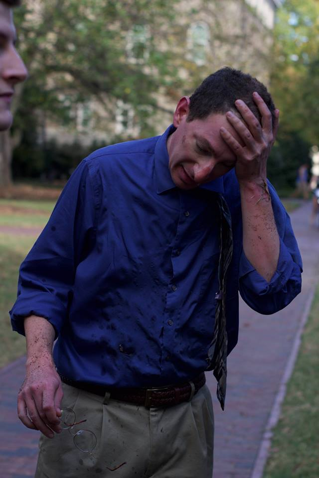 "<div class=""meta image-caption""><div class=""origin-logo origin-image none""><span>none</span></div><span class=""caption-text"">Bystander moments after being burned by the explosion (Evan White/@EJWimages)</span></div>"