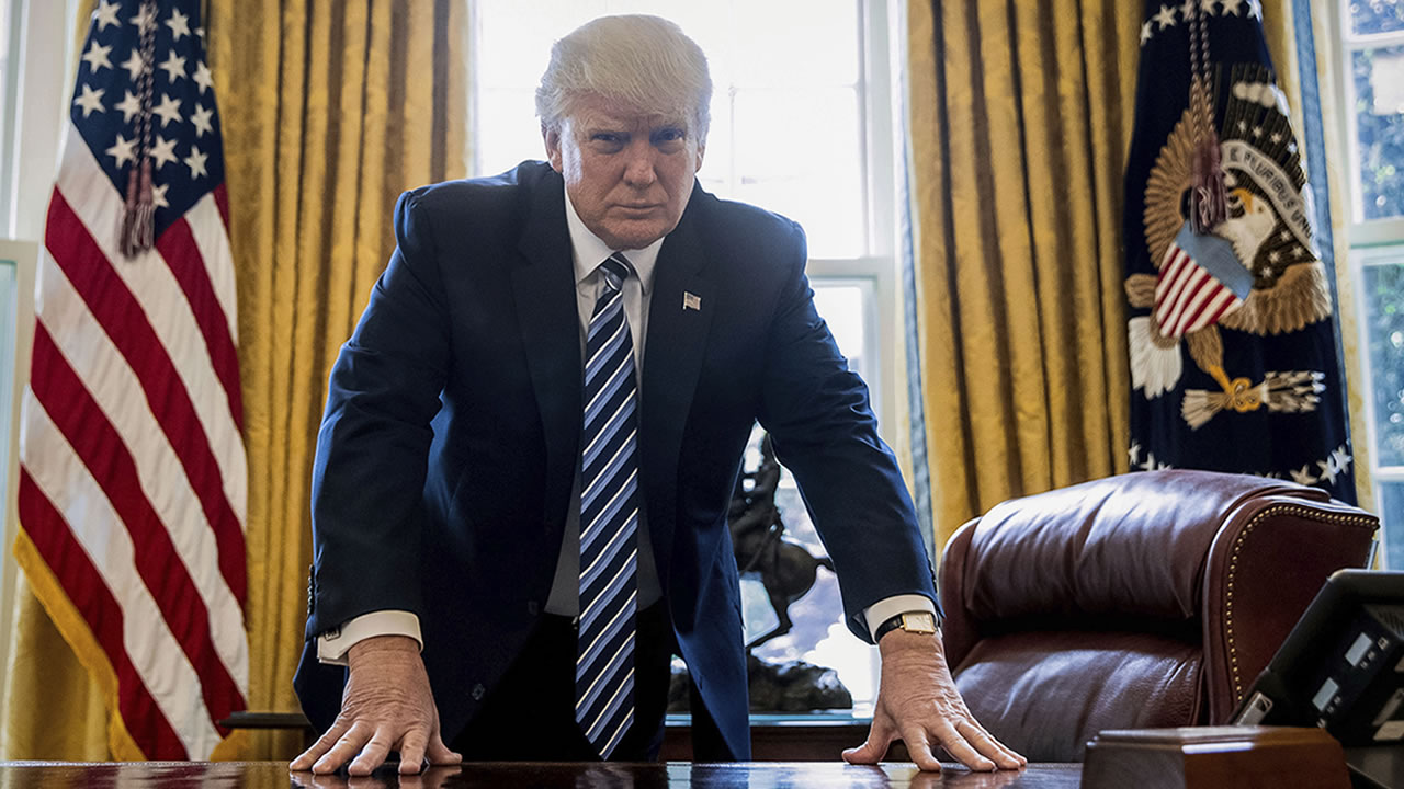 President Donald Trump poses for a portrait in the Oval Office in Washington, Friday, April 21, 2017. (AP Photo/Andrew Harnik)