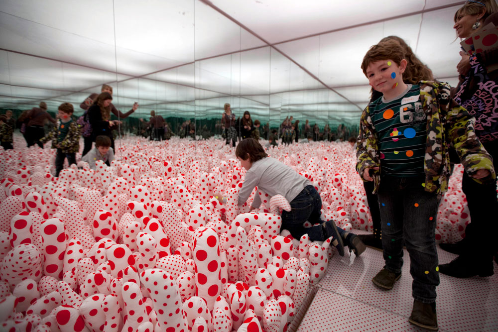 "<div class=""meta image-caption""><div class=""origin-logo origin-image ap""><span>AP</span></div><span class=""caption-text"">Children enjoy an art installation that is part of the exhibition ""Infinite Obsession"" of Yayoi Kusama at the Malba Art Museum in Buenos Aires, Argentina, Monday, July 15, 2013. (AP Photo/Natacha Pisarenko)</span></div>"