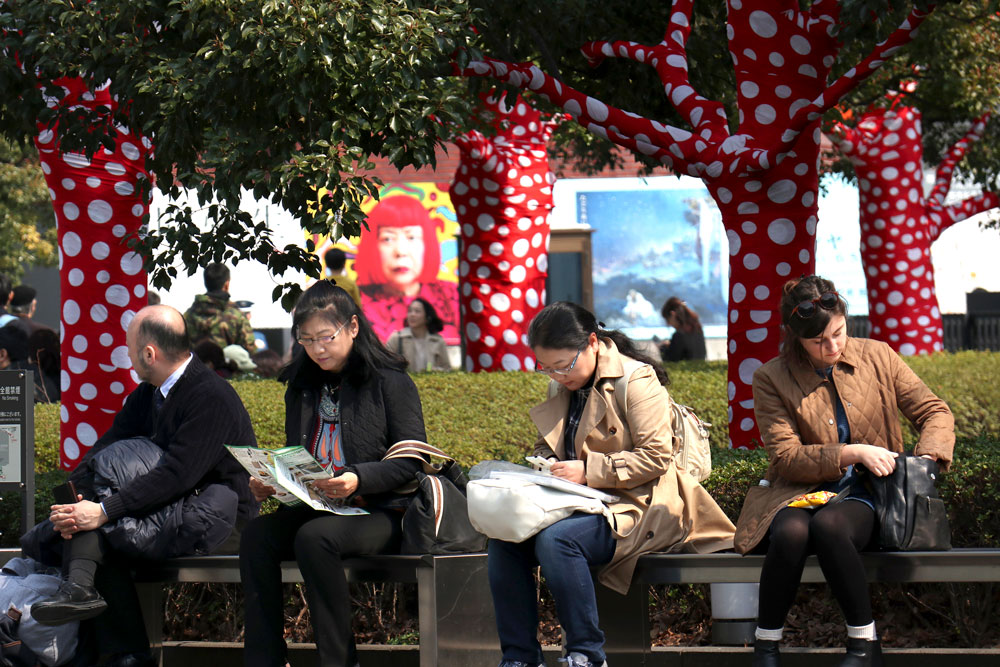 <div class='meta'><div class='origin-logo' data-origin='AP'></div><span class='caption-text' data-credit='AP Photo/Shizuo Kambayashi'>Visitors rest outside the New National Art Center where an exhibition of Japanese artist Yayoi Kusama is being held in Tokyo Sunday, March 19, 2017.</span></div>