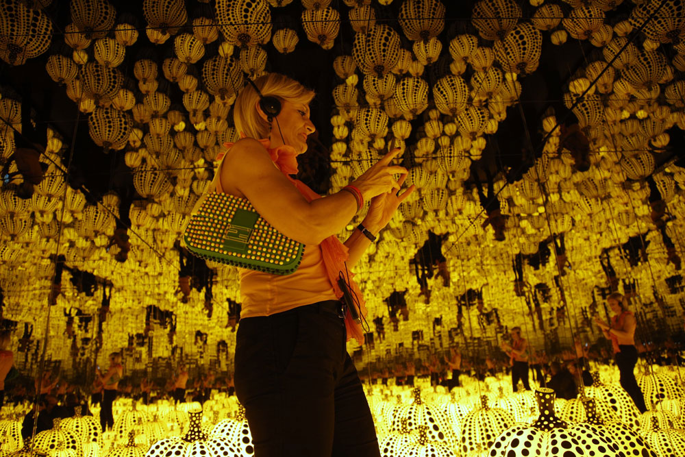 <div class='meta'><div class='origin-logo' data-origin='AP'></div><span class='caption-text' data-credit='AP Photo/Domenico Stinellis'>A woman walks past the work &#34; All the eternal love i have for the pumpkins &#34; by Yayoi Kusama in Rome, Wednesday Sept. 28, 2016.</span></div>