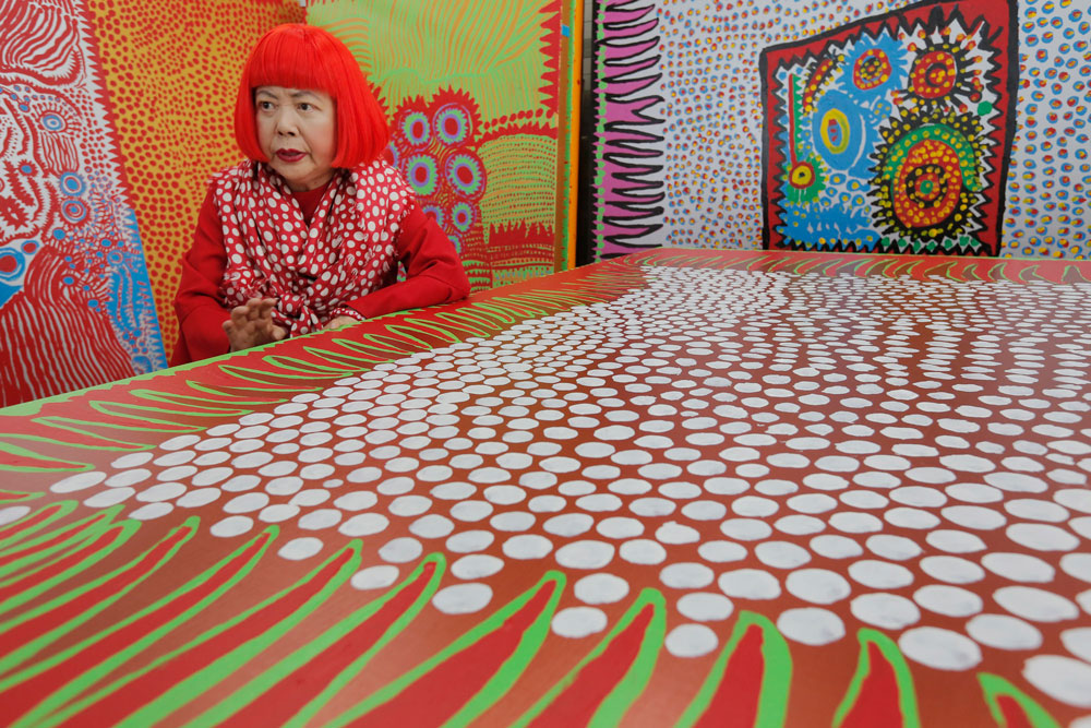 "<div class=""meta image-caption""><div class=""origin-logo origin-image ap""><span>AP</span></div><span class=""caption-text"">In this photo taken Wednesday, Aug. 1, 2012, Yayoi Kusama speaks during an interview at her studio, filled with wall-sized paintings throbbing with her repetitive dots, in Tokyo. (AP Photo/Itsuo Inouye)</span></div>"