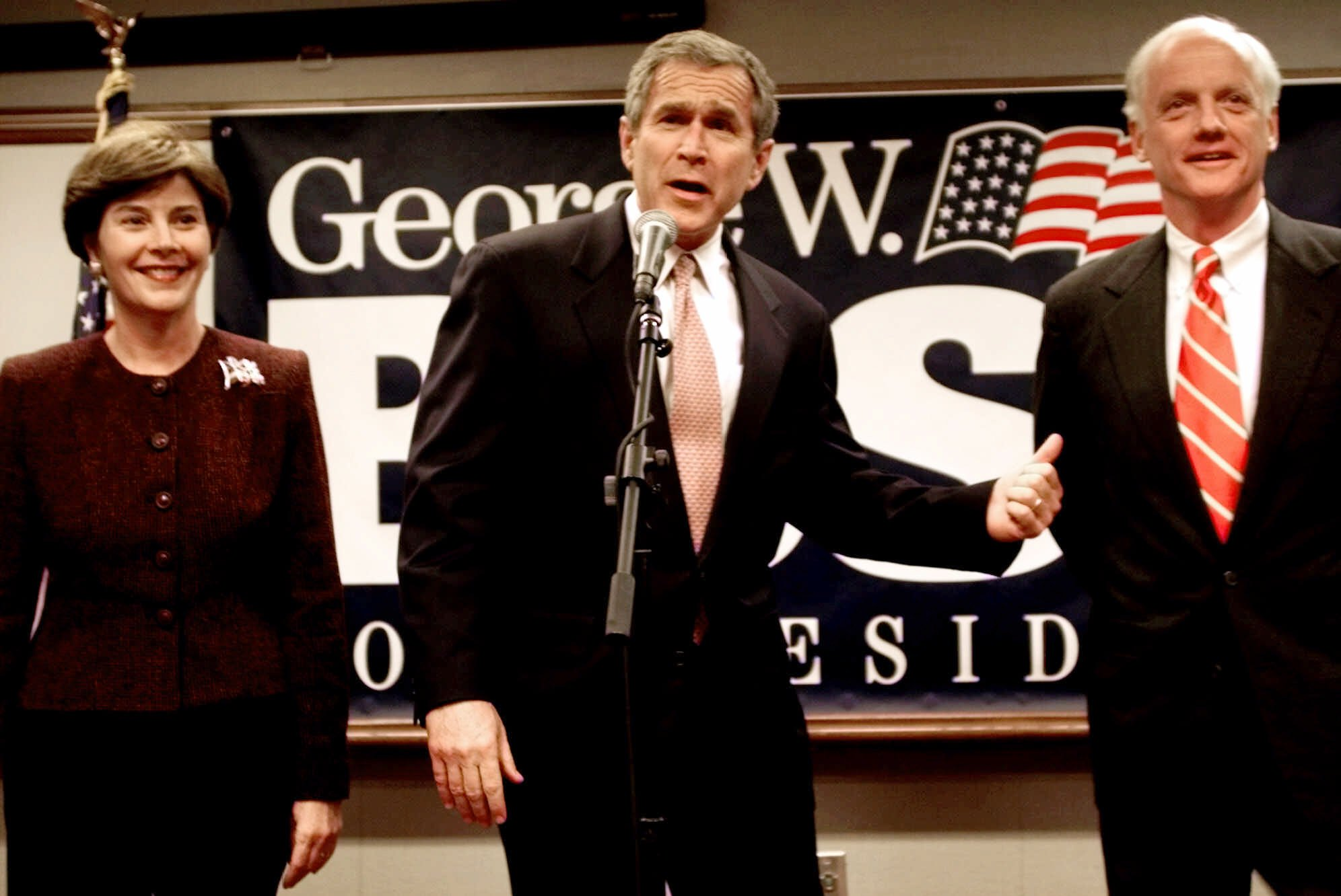 <div class='meta'><div class='origin-logo' data-origin='none'></div><span class='caption-text' data-credit='ASSOCIATED PRESS'>Flanked by his wife, Laura, Republican presidential candidate George W. Bush points to fellow Governor Oklahoma's Frank Keating at a campaign rally.</span></div>