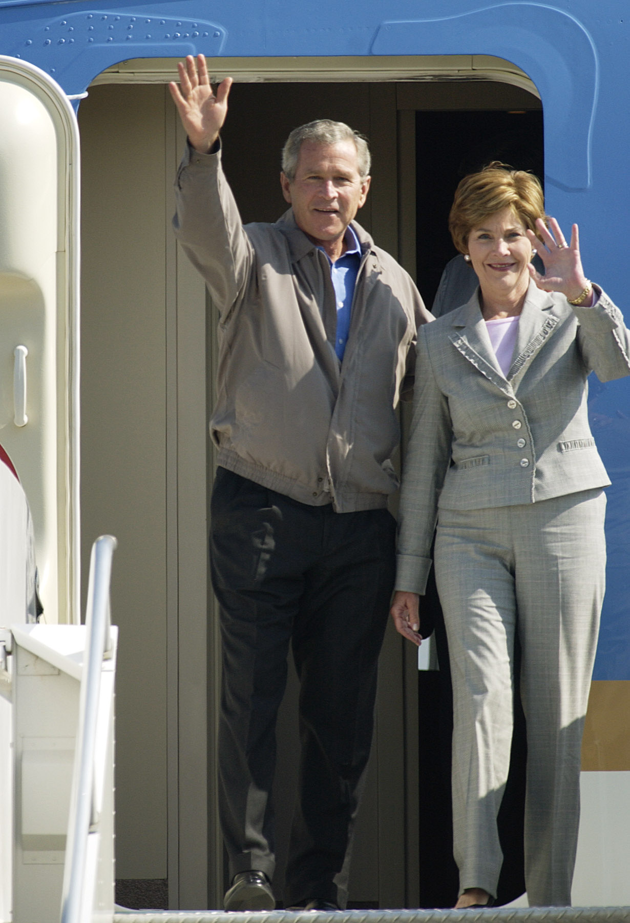 <div class='meta'><div class='origin-logo' data-origin='none'></div><span class='caption-text' data-credit='AP Photo/John Klicker'>President Bush and First Lady Laura Bush and wave to onlookers and supporters, Friday, Aug. 13, 2004, as they step off of Air Force One in Portland, Ore.</span></div>
