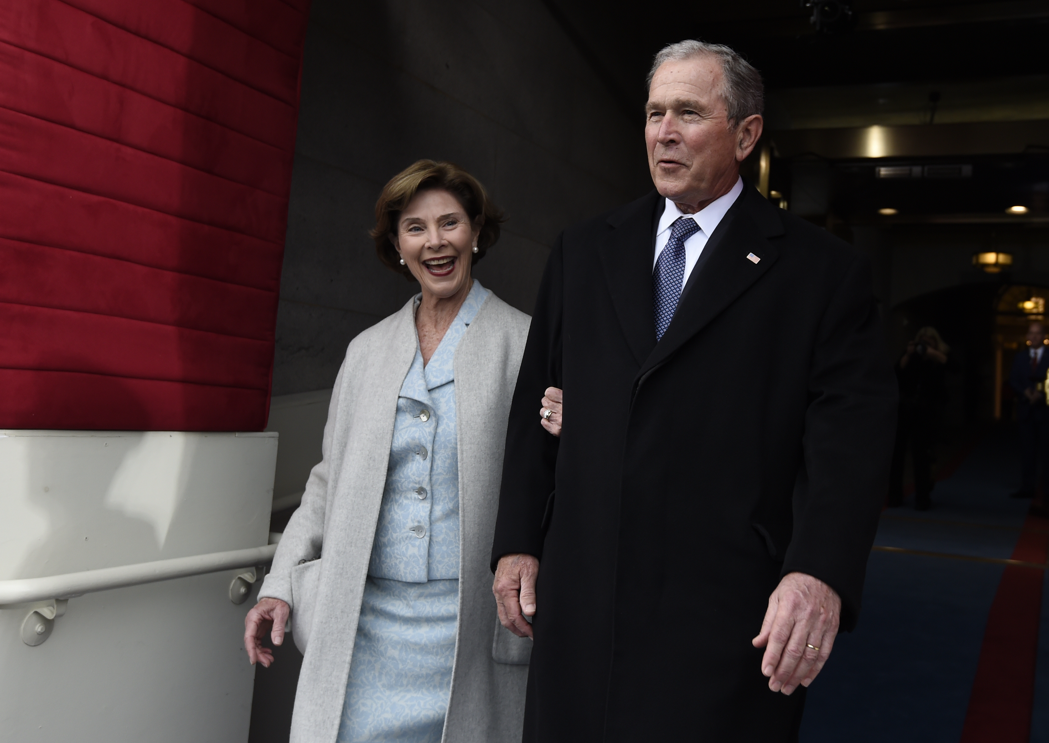 <div class='meta'><div class='origin-logo' data-origin='none'></div><span class='caption-text' data-credit='AFP PHOTO / POOL / SAUL LOEB'>Former US President George W. Bush and First Lady Laura Bush arrive for the Presidential Inauguration of Donald Trump at the US Capitol in Washington, DC, January 20, 2017.</span></div>