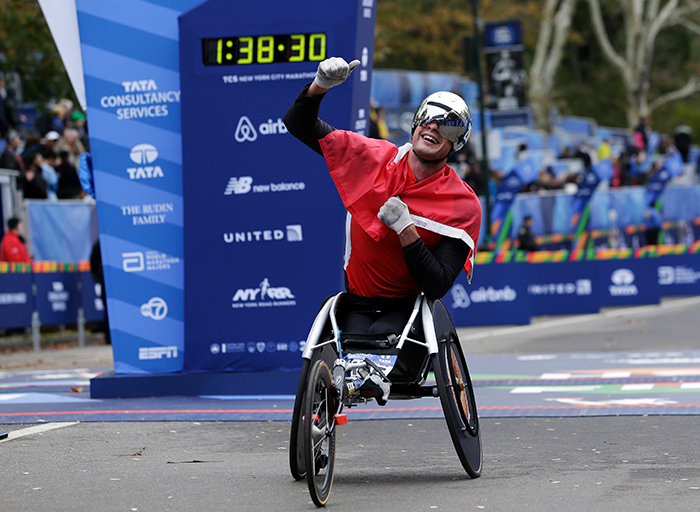 "<div class=""meta image-caption""><div class=""origin-logo origin-image ap""><span>AP</span></div><span class=""caption-text"">Marcel Hug of Switzerland reacts after crossing the finish line first in the men's wheelchair division of the New York City Marathon in New York. (AP Photo/Seth Wenig)</span></div>"